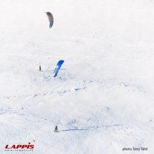 snowkiters exploring landscape pallas